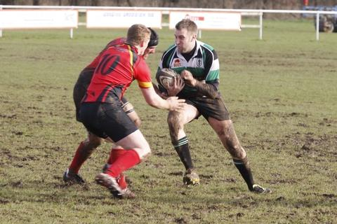 Battle: Andrew Bowl goes on the charge in the Kings Norton versus Woodrush derby. Picture: CRAIG ROSS