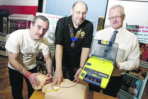 Birchensale receives lifesaving equipment: Robert Underwood, Bill Southworth, president of Redditch Lions, and Tim Jones, deputy head of Birchensale. Buy this photo pRA10sadsuk_a