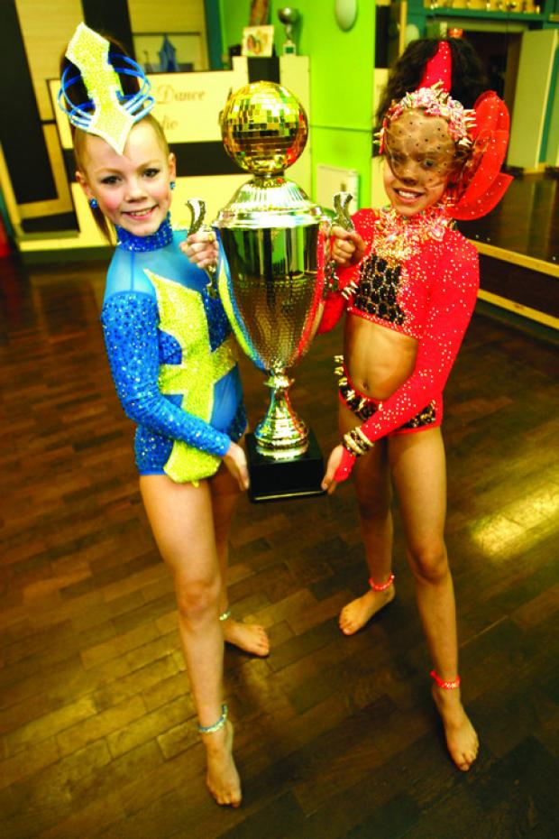 Dancing queens: Madeleine Barnwell, aged 12, and Kyra Hicks, aged nine.