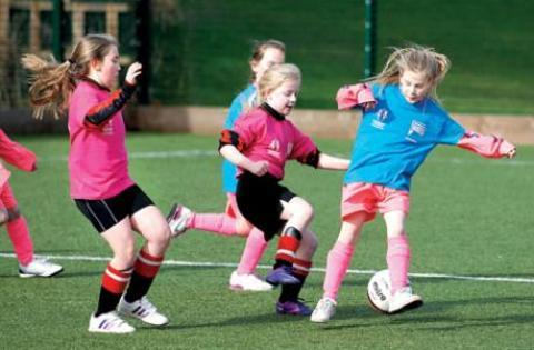 KICK-START: Sports like girls football will be boosted by the £1.7 million county primary schools will receive