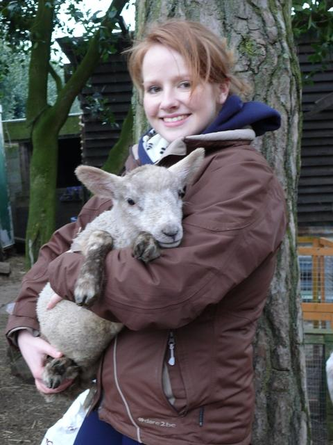 Sanctuary volunteer Fran Kingston with an orphaned lamb