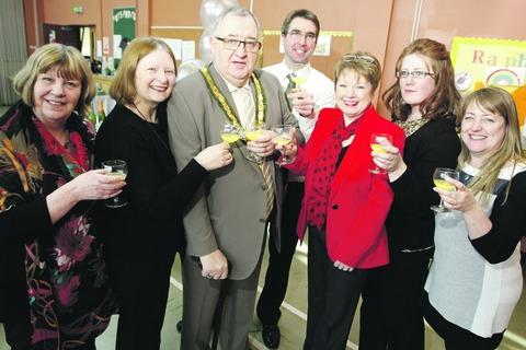 Celebrating 25 years of caring for carers. Members of Carers Careline with mayor Alan Mason. Buy this photo RCR131305a
