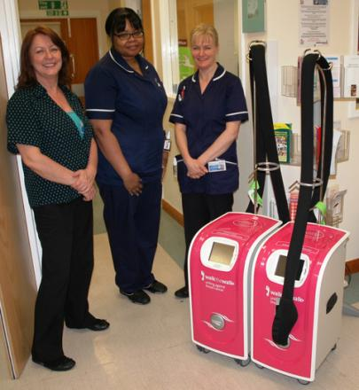 Ward clerk Kim Smart with chemotherapy sisters Alison Harrison and Brenda Francis and the new scalp cooling equipment
