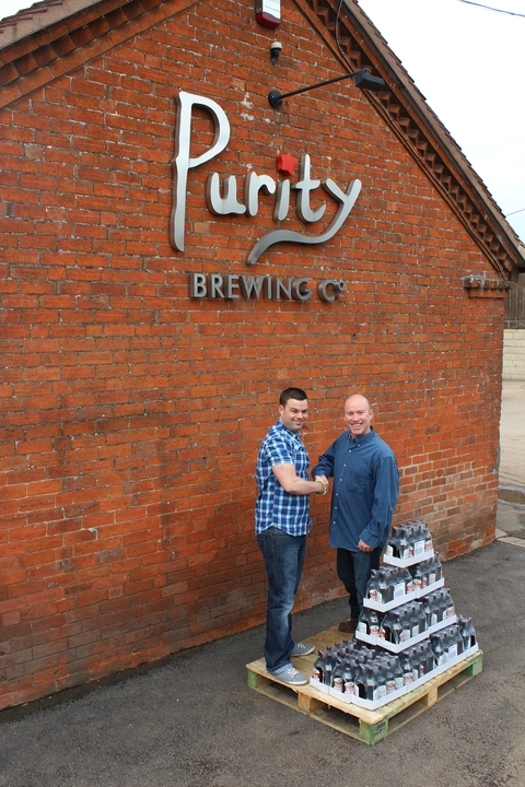 Competition winner Mark Harrison, with Simon Lewis, Purity's head of sales and distribution, and Mr Harrison's weight in beer.