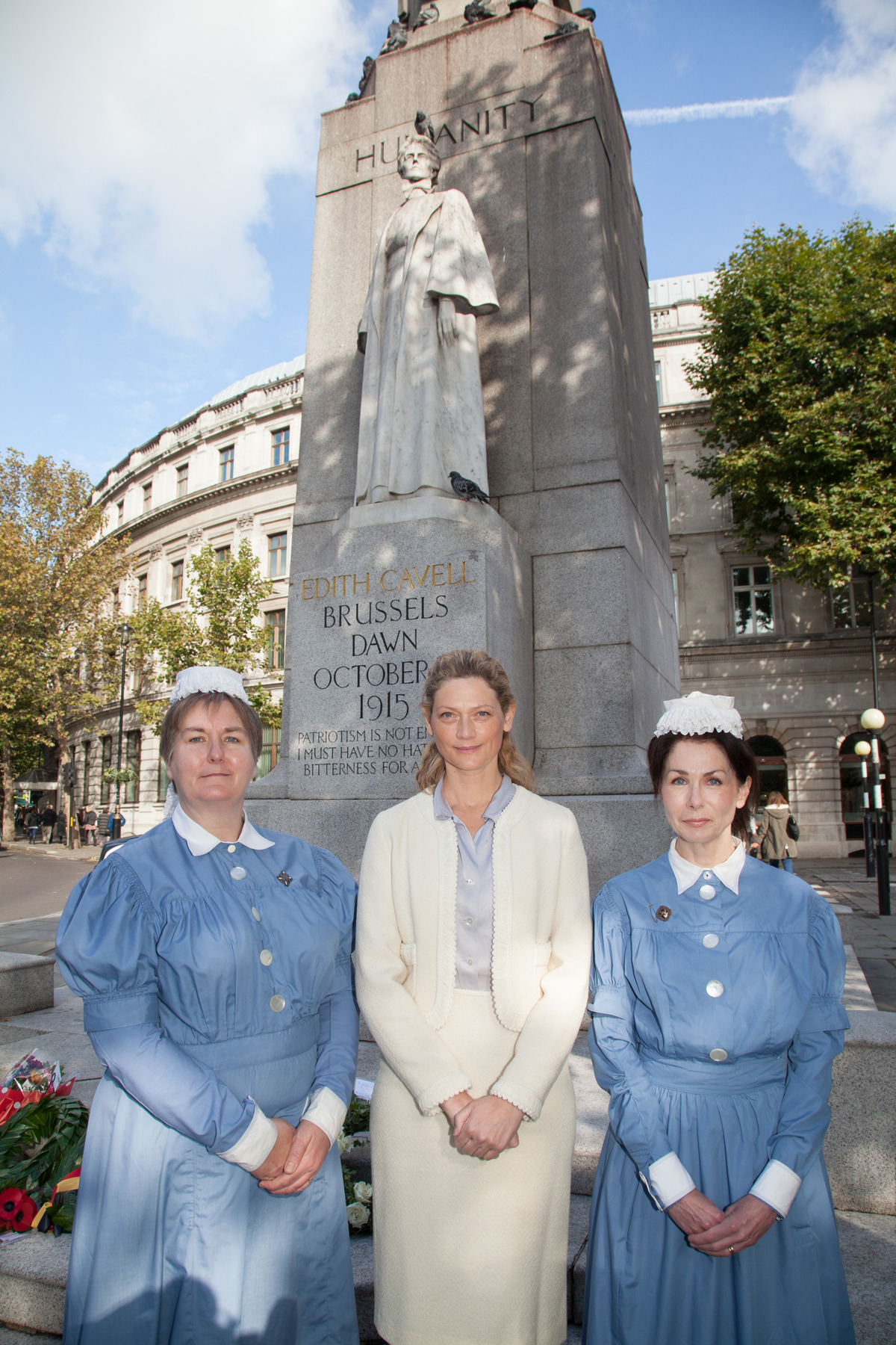 Actress Sophie Ward at the wreath-laying ceremony in London with nurses Gayle McDonnell and Shirley Turrell from the Royal London Hospital in traditional uniform