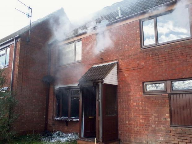 Redditch Advertiser: Fire ripped through a house in Heronsfield Close, Church Hill South, leaving nothing but a shell. SP