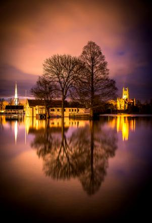 Worcester Cathedral basks in the evening light, reflected in floodwater. Picture by