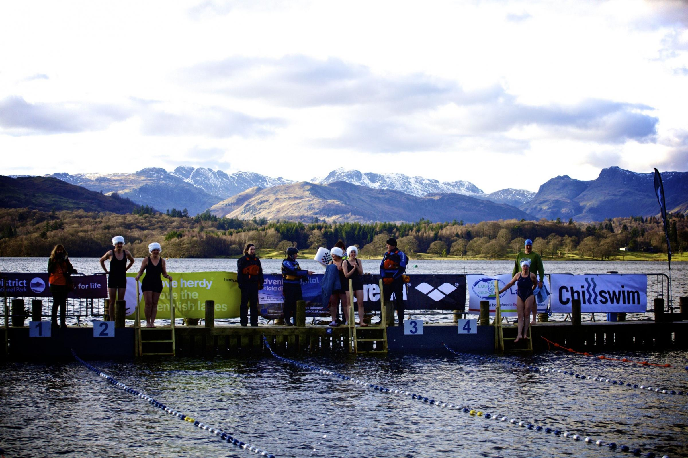 Swimmers chilling in the Lake District