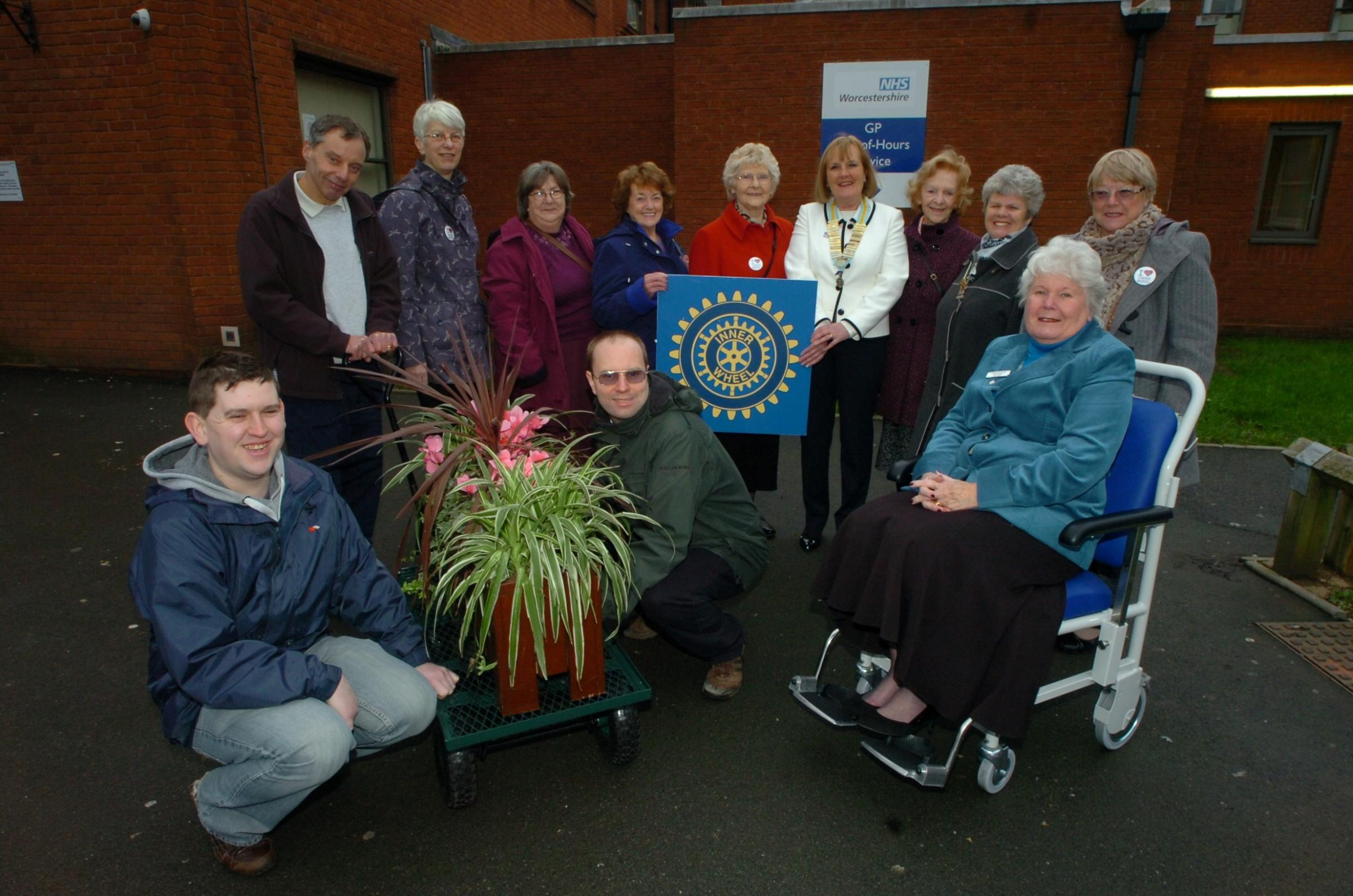 RMM061401 Redditch Inner wheel club have donated money to Alex hospiutal league of friends & where next: (L) Dale Platten, Nick Houghton, & Barry King (C) Liz Ostroumoff - District 6 chair, (Far R) in wheelchair Pat Hadley - Chair leauge of friend