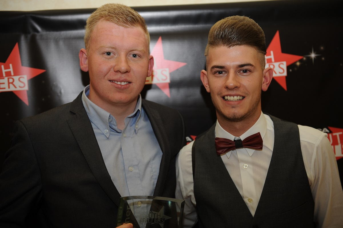 Tom Smallman receives his award from last year's winner Lewis Barkway