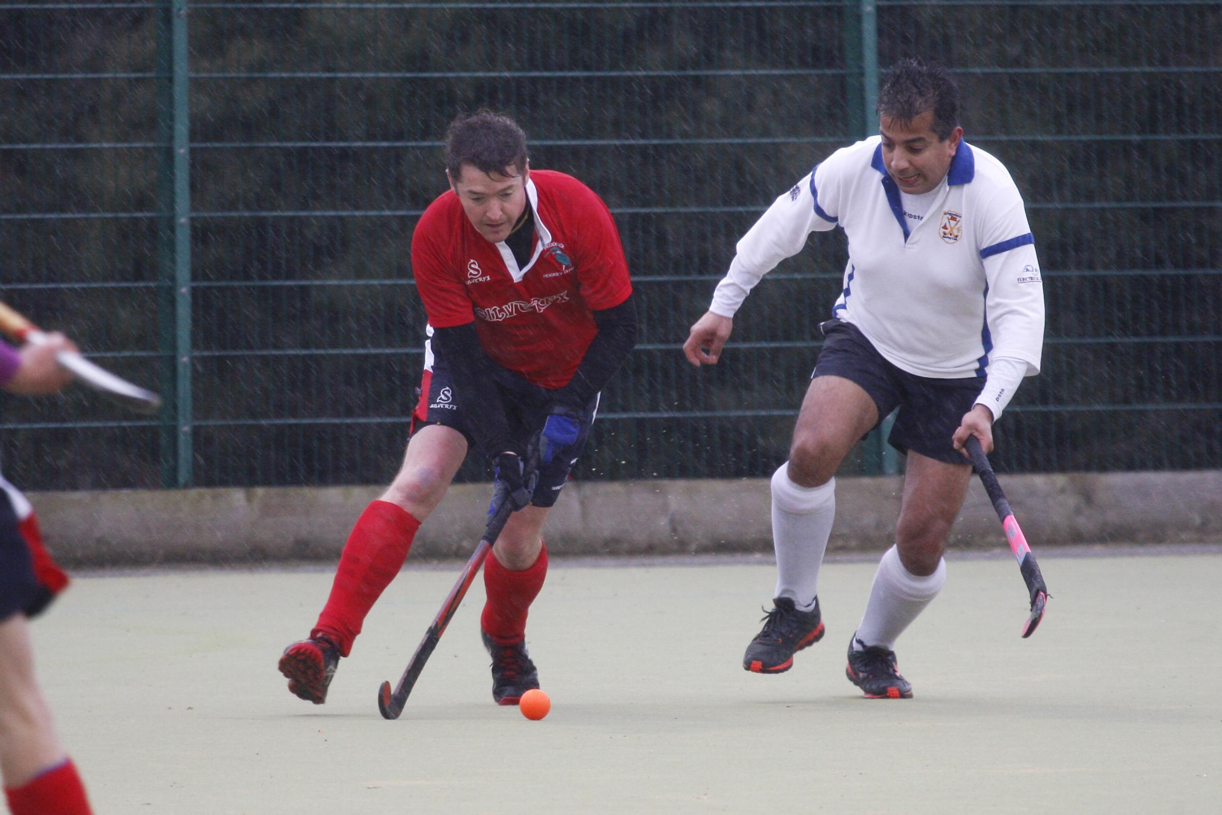 Action from Redditch Hockey Club's men's match against Kingstanding. Picture: CRAIG ROSS
