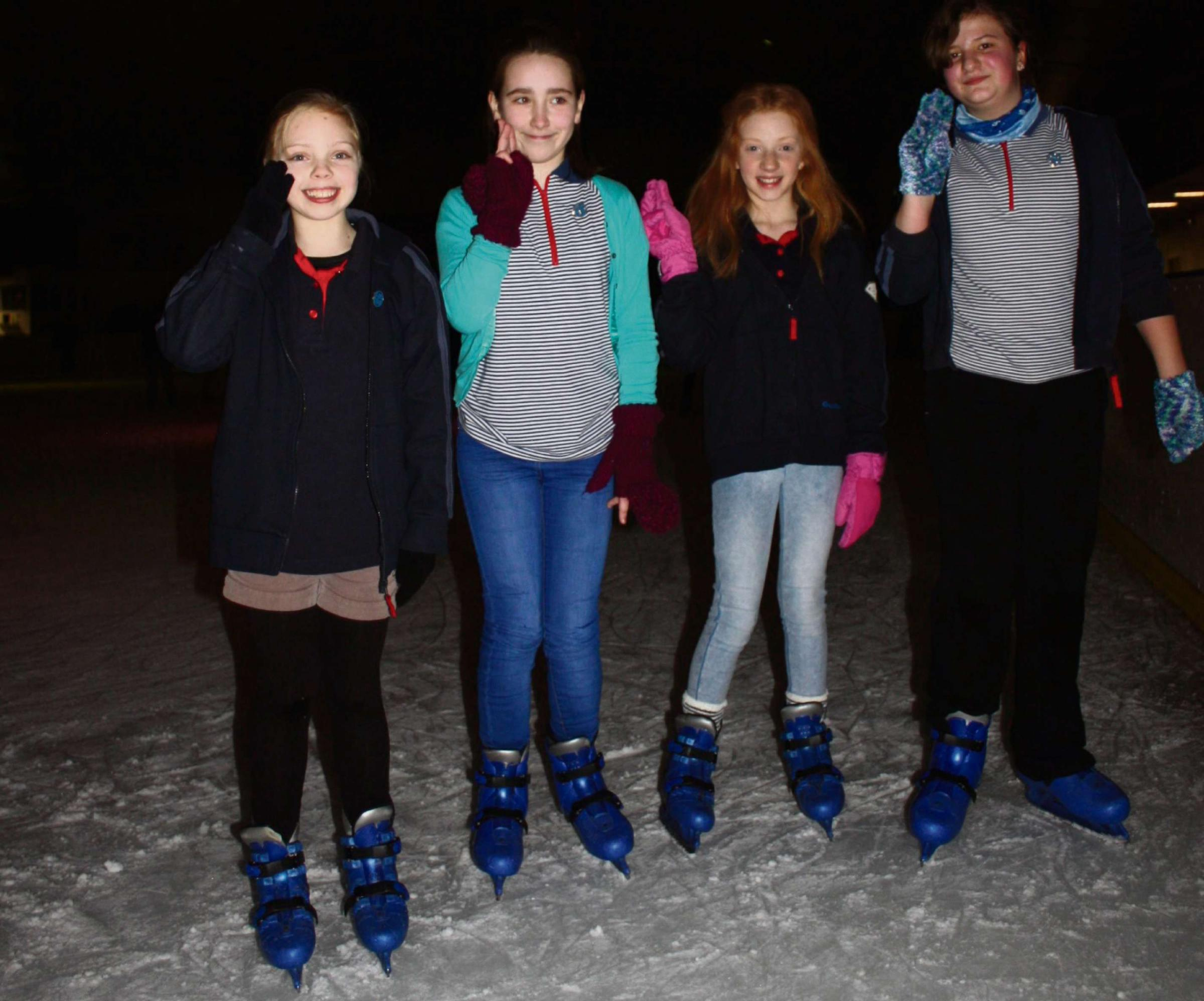 Ellie Taylor, Katie Daniel, and Ella and Molly Povey take their Guide promise on the ice. SP