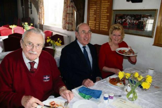 Retired Major Bob Woodfield MBE, Councillor Eric Payne and his wife Maggie tucking into a fry-up