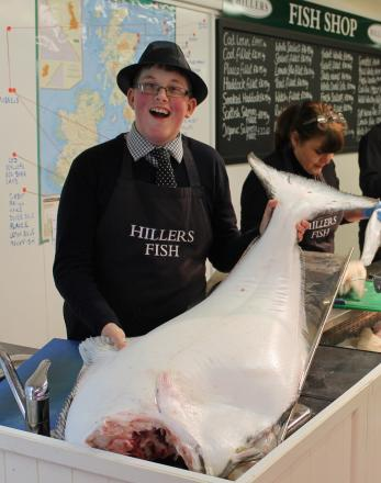 Fishmonger Harry Dyke with the massive halibut he sold recently