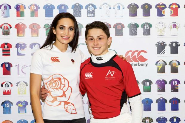 Will Grimley, proudly wearing the unique rugby shirt designed by his school with England Rugby's official anthem singer, soprano Laura Wright.
