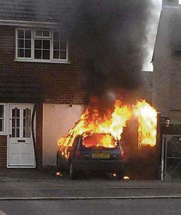A car fire at a home in Alcester