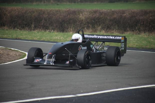 Redditch Advertiser: Speed demon: Redditch's Dave Uren tackles a corner in his Force PC single seater.