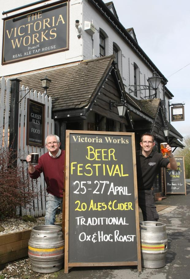 Redditch Advertiser: CHEERS: Dave and Toby Smith celebrate the Victoria Works' victory. Photo courtesy of Mike Ford