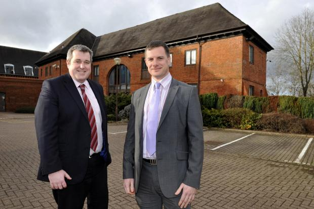 Redditch Advertiser: Ian Parker and Ben Truslove of John Truslove pictured at the Ipsley Court offices development in Redditch