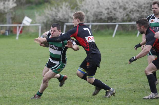 Get a grip: A Woodrush attacker tries to brush aside a tackler. Picture: CRAIG ROSS