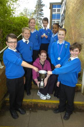 Teacher Katie Reeves with the students who helped to win the district swimming gala. PICTURE: Marie Myers
