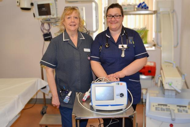 Cardiac assessment nurses with Worcestershire Acute Hospitals NHS Trust Sue Amos and Sally Baker with a cardioversion machine