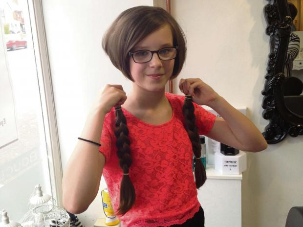 Lucy Jones had her long plaits cut off to help the Little Princess Trust. SP