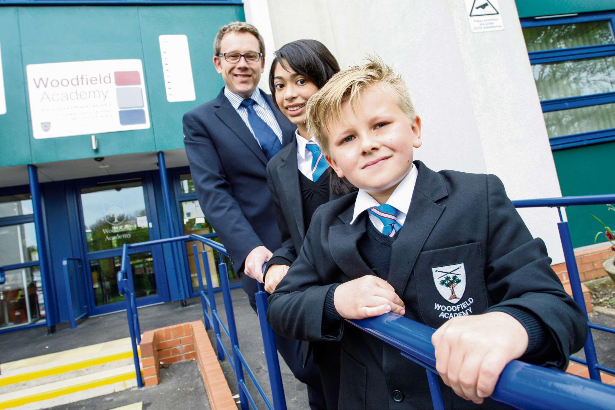 New headteacher Stephen Bond with pupils Luke Taylor and Ismat Qureshi. Buy this photo Ref. RCR191402_01 at redditchadvertiser.co.uk/pictures or call 01527 889027.