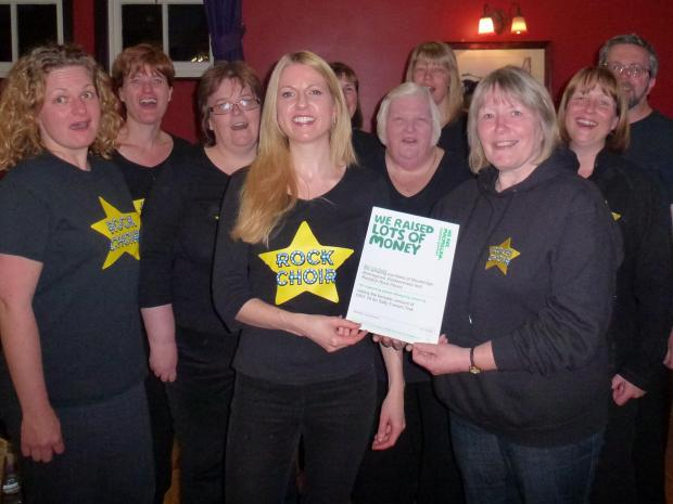 Choir leader Christa Hugo, Sally Turner and other members of the group