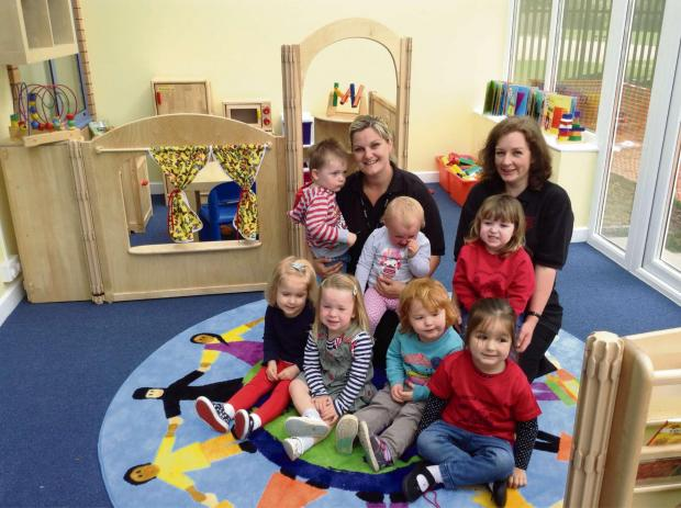 Redditch Advertiser: Kelly Cusack, senior early years practitioner, and Rosa Burden with youngsters.
