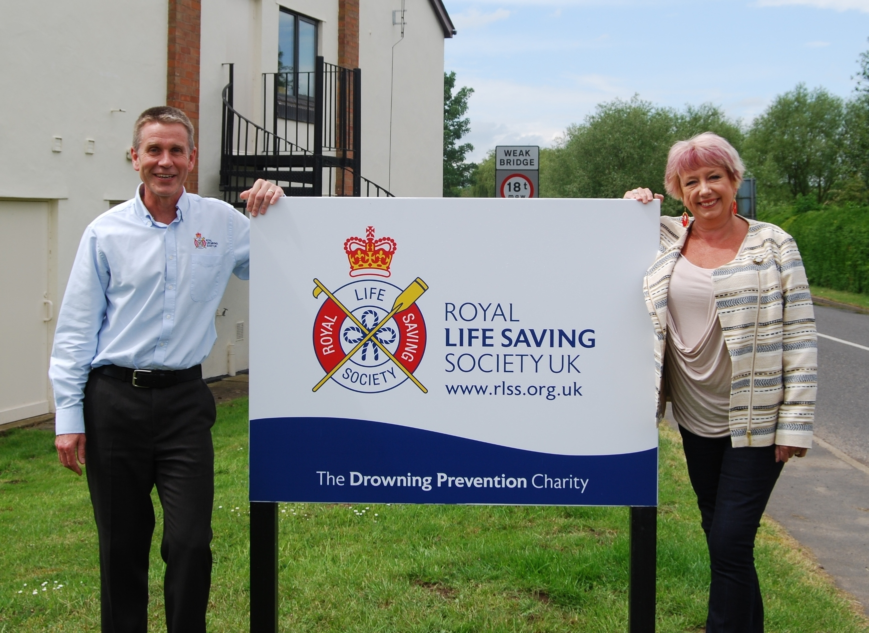 RLSS UK's Director of Lifesaving, Adrian Lole, and Redditch MP Karen Lumley during her visit to the charity's headquarters. SP