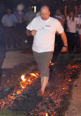 Adrian Taylor, chairman of SWDA, who was first to do the firewalk. SP