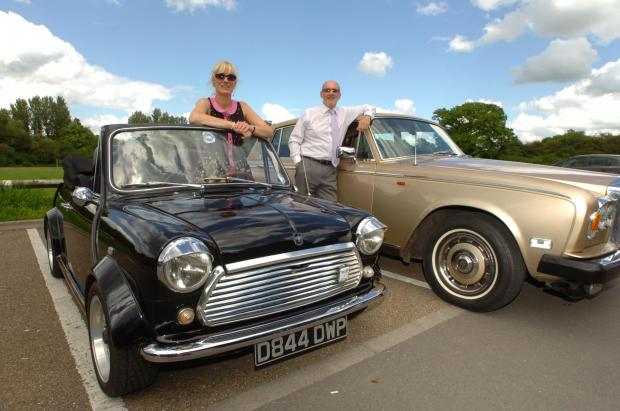 Dagmar Prinzing and Mike Andrews with their classic cars, which will be on display at the Green Fair. Buy photo RMM241402 at redditchadvertiser.co.uk.