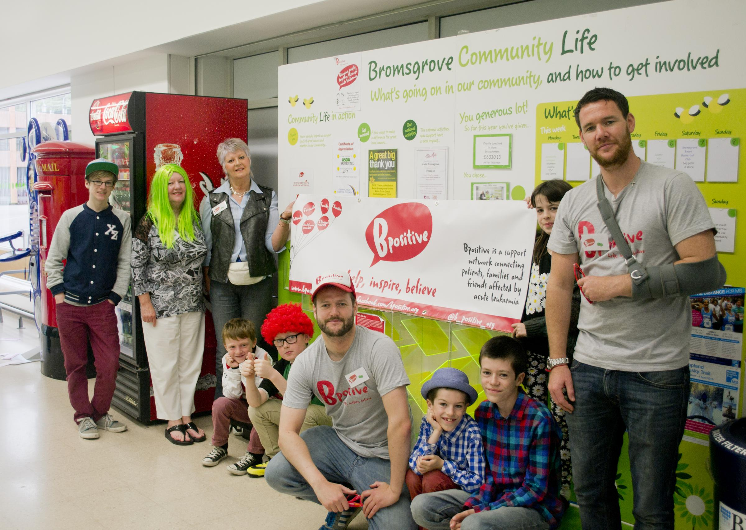 Jonjo Rooney (centre) who set up the charity Bpositive with volunteers at Asda in Bromsgrove.