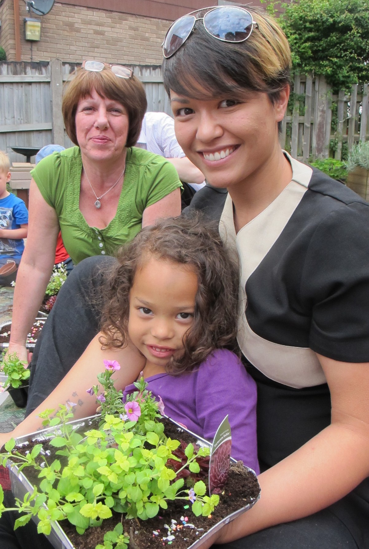 Joan Fuller, gardening club organiser, with Teah Chik-Bailey, aged four, and her mum Tamsin. SP