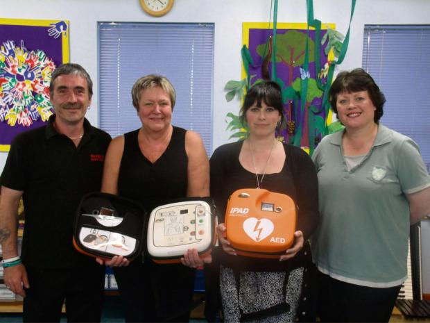 Redditch Advertiser: Robert Underwood, with  Di Potter, Glenda Patrick and Shirley Smith from Vaynor First School. SP