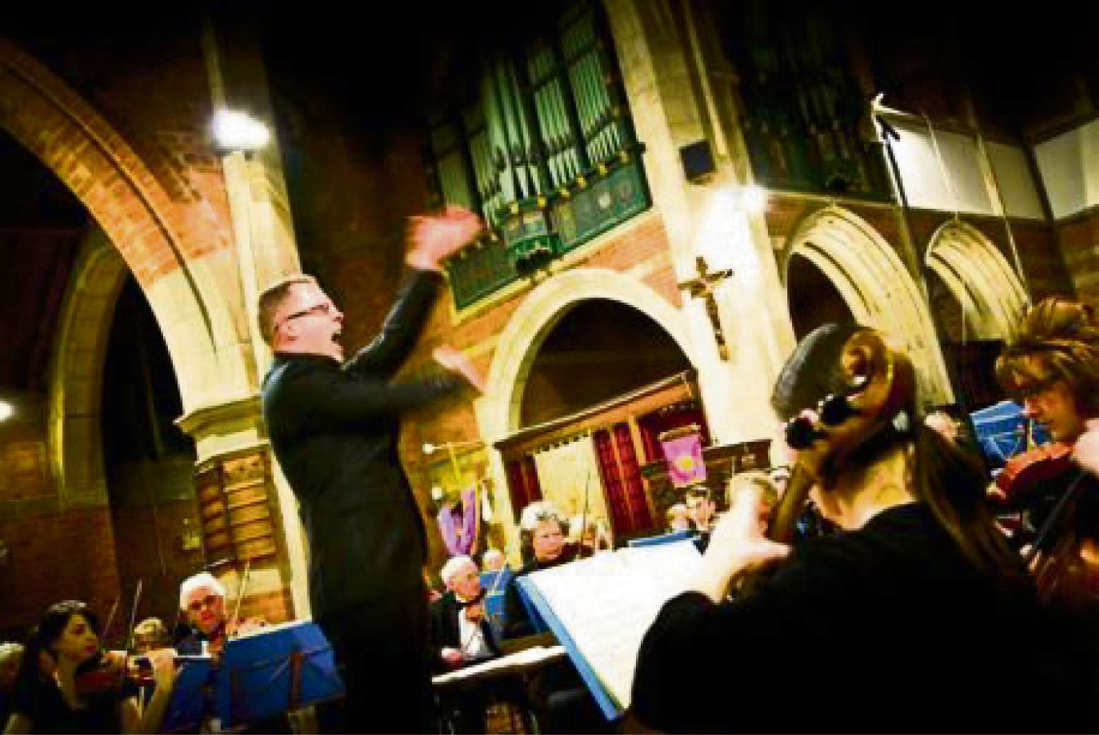 The orchestra's conductor Keith Slade in action.