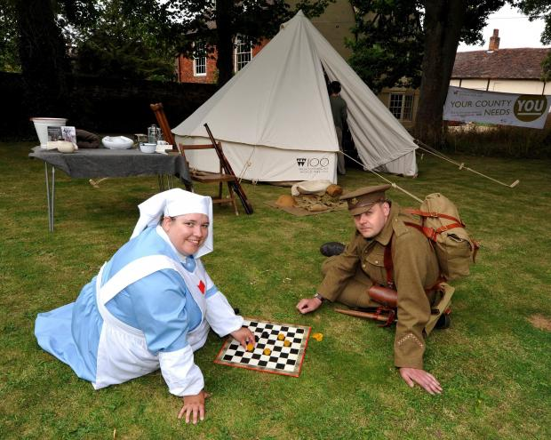 Redditch Advertiser: John Anyon       26/06/14     2614635301  First World War replica Bell Tent in the Commandery Garden, an event which is part of the Worcestershire World War One Hundred Project.........................VAD Nurse Helen Lee and Worcestershire Regiment soldie