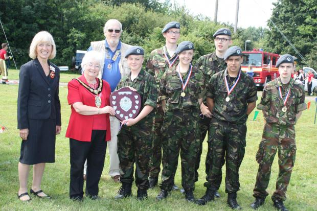 Redditch Advertiser: Deputy Lord Lieutenant of Worcestershire Patricia Bradley, Redditch mayor Pat Witherspoon presenting the trophy, and Victor Johnson Redditch Lions president, with winning members of ATC 216 Squadron. SP