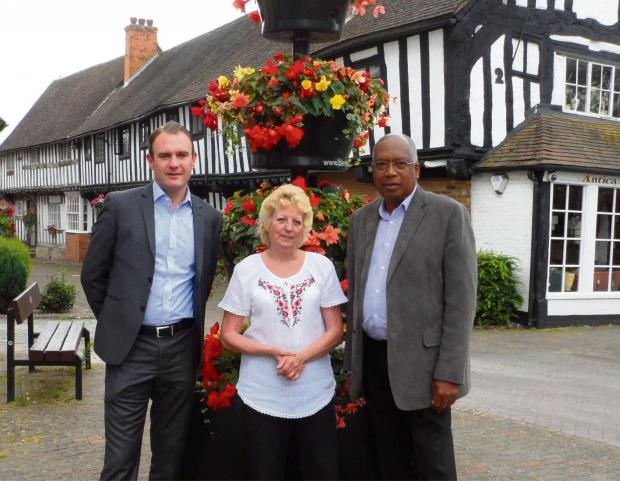 Iwan Jones, managing director of Renaissance Villages, with Maggie Payne from Alcester in Bloom, and Councillor Lennox Cumberbatch, chairman of the recreation and open spaces committee for Alcester Town Council. SP