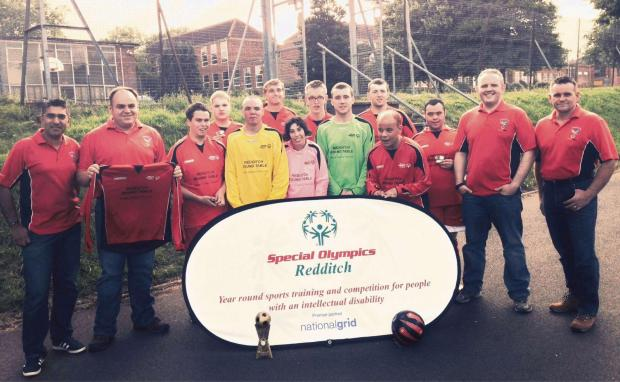 Members of Redditch Round Table with players from Special Olympics Redditch football team. SP