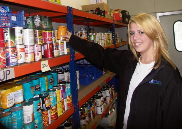 Emily Attwell sorting food items at Redditch's food bank.