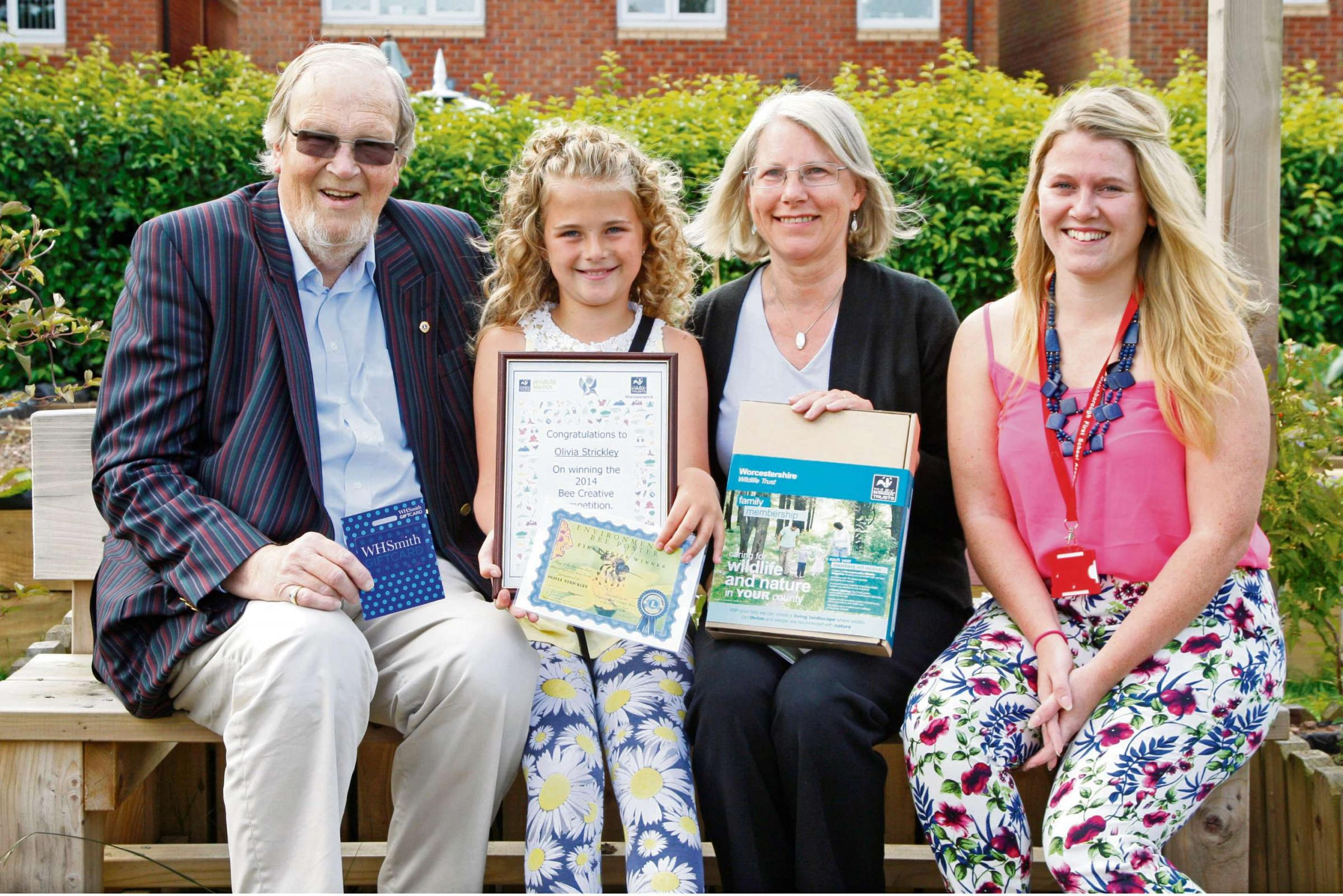 Victor Johnson from Redditch Lions, prize winner Olivia Strickley, Linda Butler from Worcestershire Wildlife Trust, and teacher Elizah Barnes. Buy this photo RCR291401_01from redditchadvertiser.co.uk/pictures