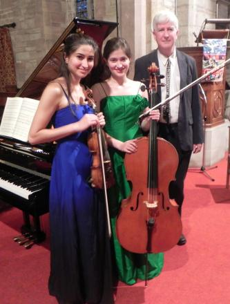 Francis Grier with daughters Savitri, on violin, and Indira, on cello,  in St Peter's church, Inkberrow, which hosted the concert.  SP