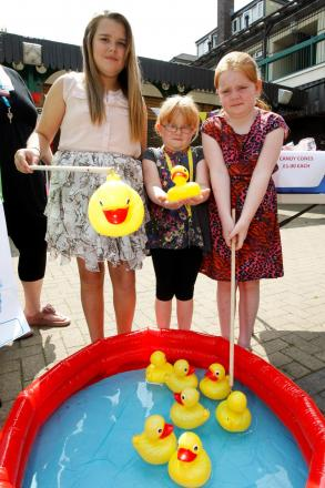 Grace, Chloe, and Millie Tibbetts enjoy the community fun day in Woodrow. Buy this photo RCR321402_03 from redditchadvertiser.co.uk/pictures