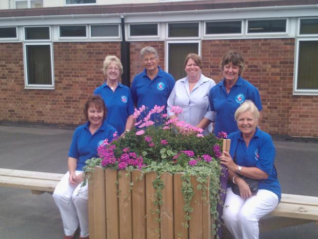 Blooming lovely: Tricia Wellings (centre) from Bright Kids with members of Studley in Bloom.