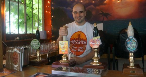 Matthew Terry serving in The Turks Head during lasy years festival.