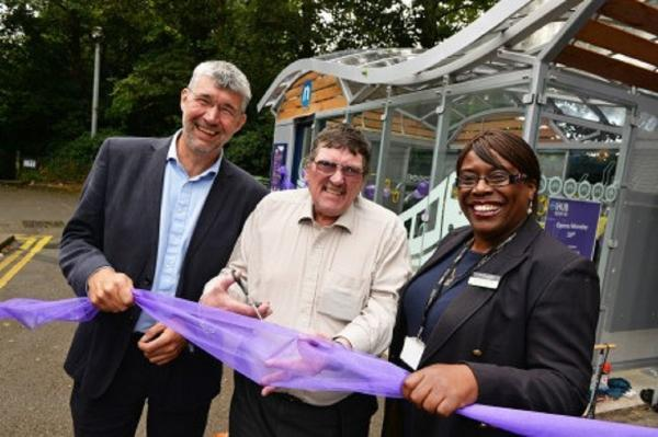 THERE'S THE HUB: Conrad Jones, Centro's head of sustainability, councillor Roger Horton and Brenda Lawrence cut the ribbon to open the cycle hub.