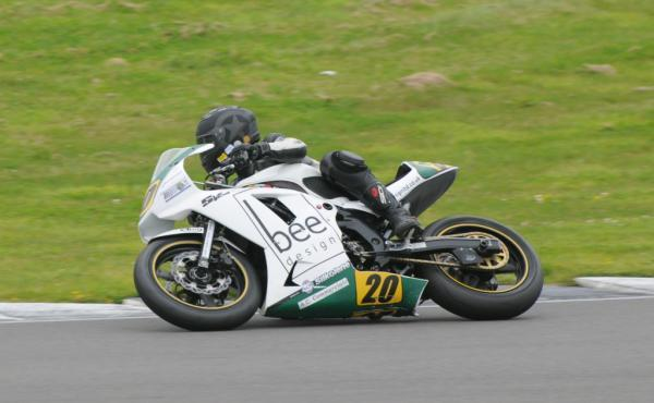 Roaring success in Wales: Bee design rider Paul Wardell tackles a corner in Anglesey.