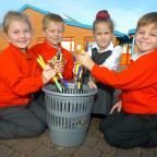 Redditch Advertiser: No Pens Day at Matchborough First School Academy: Millie Clarke, Ben Gladwin, and Chanelle Bolton, all six,  with Jay Poynter, aged five. Buy this photo RMM441401b at redditchadvertiser.co.uk/pictures